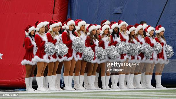 Cheerleaders of the New England Patriots stand before a game with the Cleveland Browns at Gillette Stadium on December 8 2013 in Foxboro Massachusetts
