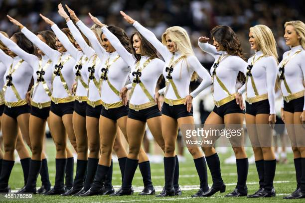 Cheerleaders of the New Orleans Saints perform before a game against the Carolina Panthers at MercedesBenz Superdome on December 8 2013 in New...