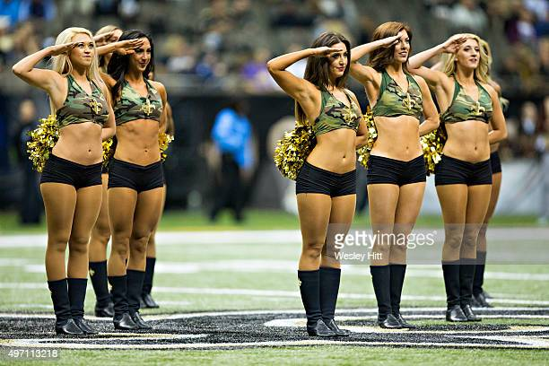 Cheerleaders of the New Orleans Saints perform before a game against the Tennessee Titans at MercedesBenz Superdome on November 8 2015 in New Orleans...