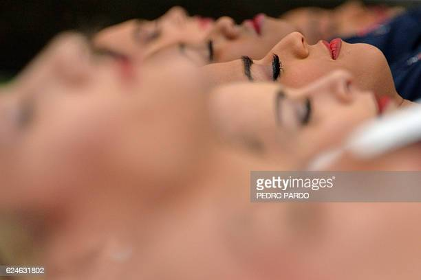TOPSHOT Cheerleaders of the NFL teams Texans and Raiders take part in a yoga class with Mexicans fans in Mexico City on November 20 2016 As the NFL...