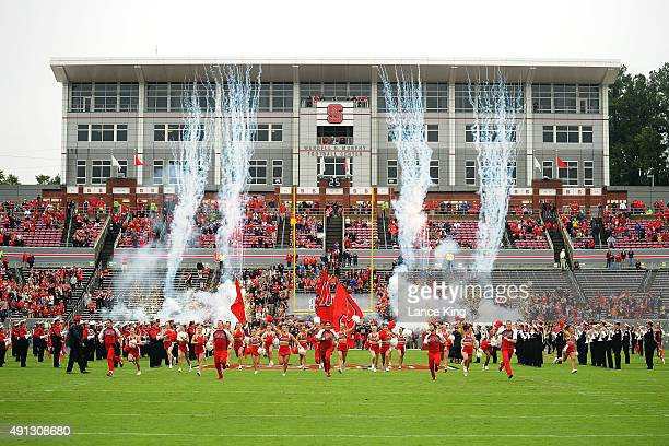Cheerleaders of the North Carolina State Wolfpack lead their team onto the field prior to their game against the Louisville Cardinals at...