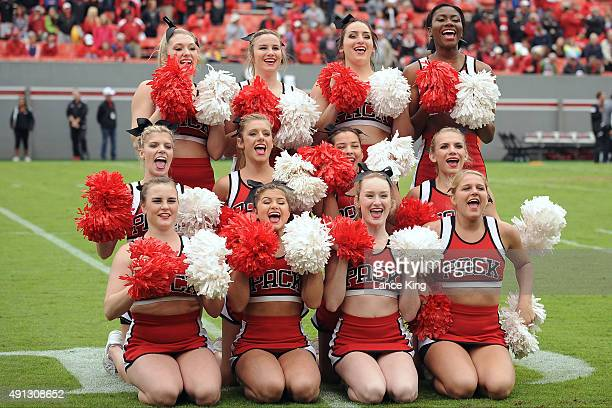 Cheerleaders of the North Carolina State Wolfpack perform during their game against the Louisville Cardinals at Carter-Finley Stadium on October 3,...