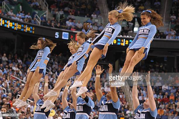 Cheerleaders of the North Carolina Tar Heels perform against the Louisville Cardinals during the quarterfinals of the 2015 Men's ACC Tournament at...