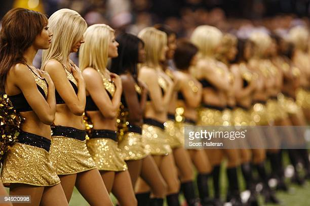 Cheerleaders of the of the New Orleans Saints stand during the national anthem prior to the game against the Dallas Cowboys at the Louisiana...