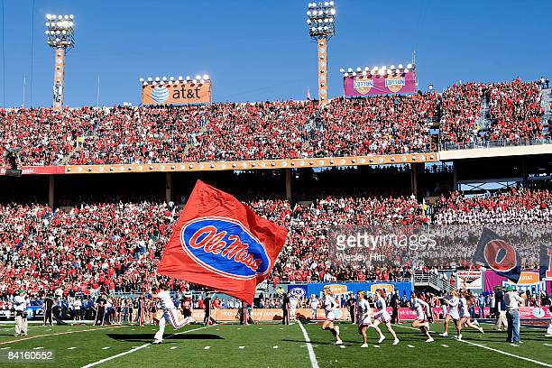 Cheerleaders of the Ole Miss Rebels run onto the field before the AT&T Cotton Bowl against the Texas Tech Red Raiders on January 2, 2009 at the...