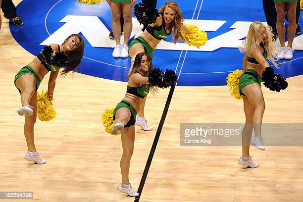 Cheerleaders of the Oregon Ducks perform during a game against the Louisville Cardinals during the Midwest Region Semifinal round of the 2013 NCAA...