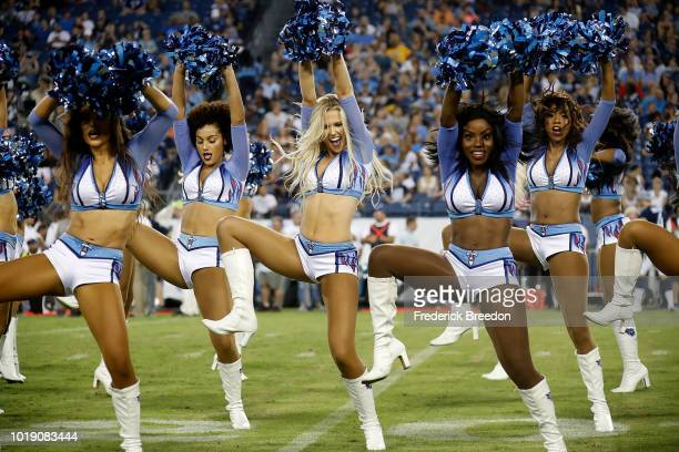Cheerleaders of the Tennessee Titans perform during the first half of a preseason game against the Tampa Bay Buccaneers at Nissan Stadium on August...