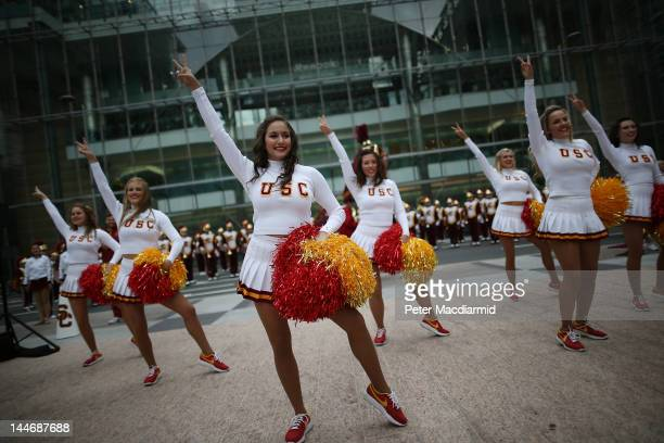 Cheerleaders of the University Of Southern California Trojan Band perform at Canary Wharf on May 17 2012 in London England This is the first visit to...
