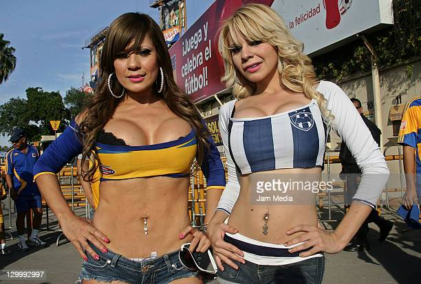 Cheerleaders of Tigres and of Monterrey during a match as part of the Apertura 2011 at Universitario Stadium on October 22 2011 in Monterrey Mexico