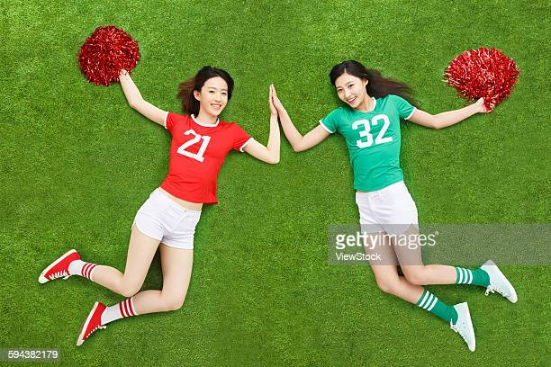 Cheerleaders on grass