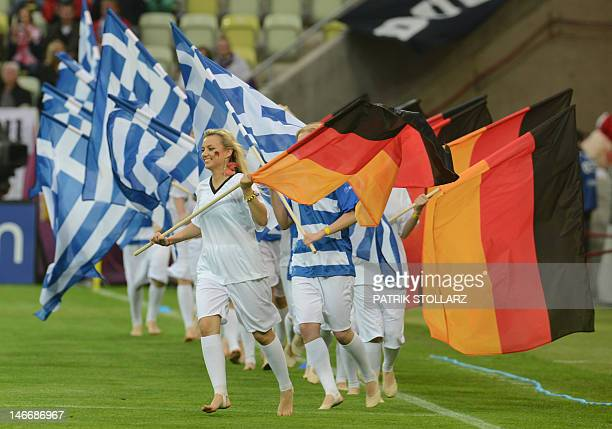 Cheerleaders parade with flags of Germany and Greece's national football teams ahead of the Euro 2012 football championships quarterfinal match...