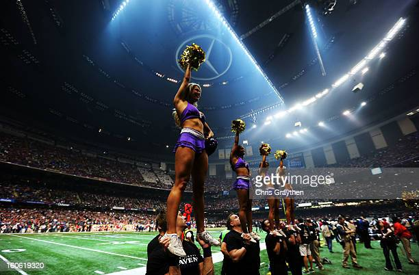 Cheerleaders perform as play was suspended for 34 minutes in the third quarter due to a power outage during Super Bowl XLVII between the Baltimore...