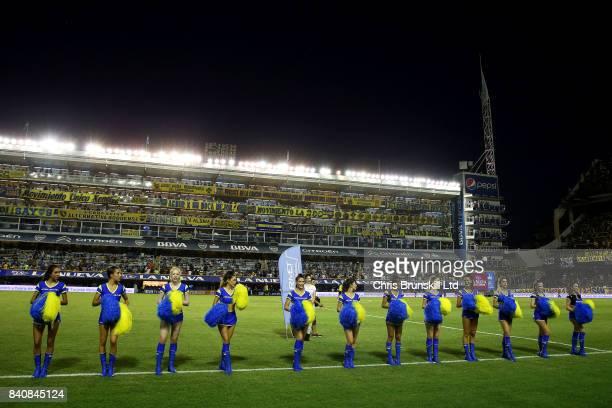 Cheerleaders perform at halftime during the Argentine Primera Division match between Boca Juniors and Atletico Tucuman at the Alberto J Armando...