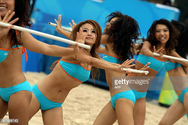 Cheerleaders perform at timeout during the women's preliminary beach volleyball match between China and Greece for the 2008 Beijing Olympic Games at...