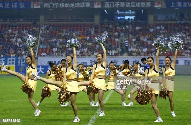 Cheerleaders perform during a match between the Shanghai Shenhua SVA and the Tianjin Kangshifu as China's soccer Division A League resumed play in...