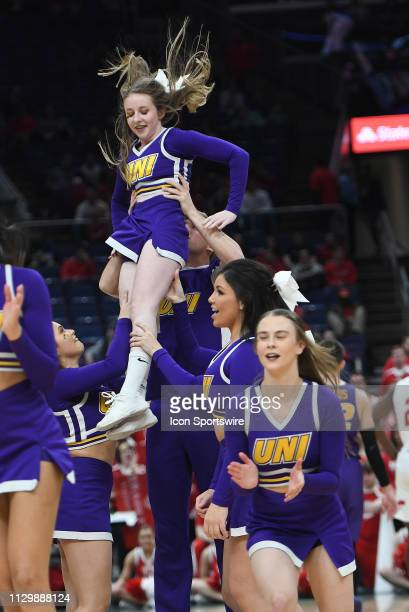 UNI cheerleaders perform during a Missouri Valley Conference Basketball Tournament game between the UNI Panthers and Bradley Braves on March 10 at...