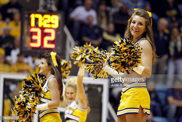 WVU cheerleaders perform during a time out during the game against the Kansas Jayhawks at the WVU Coliseum on January 28 2013 in Morgantown West...