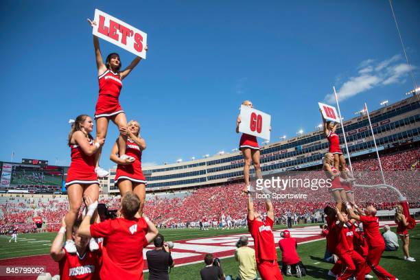 Cheerleaders perform during an NCAA football game between the Florida Atlantic Owls and the Wisconsin Badgers on September 9 2017 at Camp Randall...
