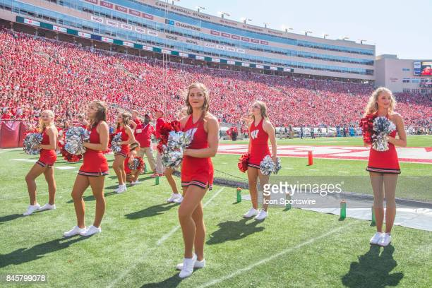 UW cheerleaders perform during an NCAA football game between the Florida Atlantic Owls and the Wisconsin Badgers on September 9 2017 at Camp Randall...