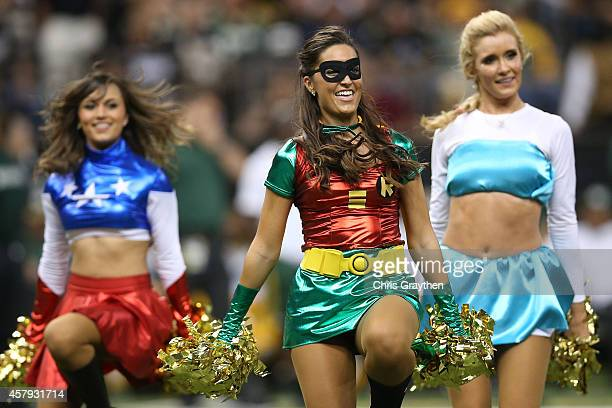 Cheerleaders perform during the game between the Green Bay Packers and the New Orleans Saints at MercedesBenz Superdome on October 26 2014 in New...