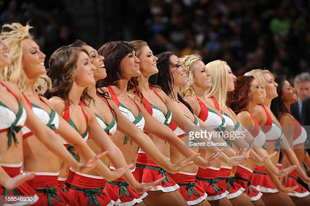 Cheerleaders perform during the game between the San Antonio Spurs and the Denver Nuggets on December 18 2012 at the Pepsi Center in Denver Colorado...