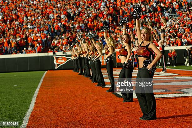 Cheerleaders perform in the end zone during the game between the Texas AM Aggies and Oklahoma State Cowboys at Boone Pickens Stadium on October 16...
