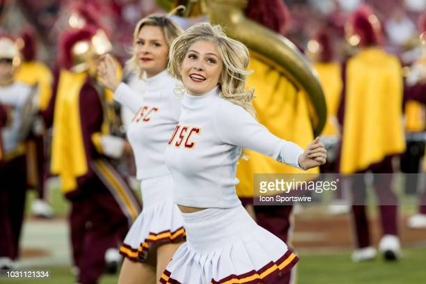 USC cheerleaders perform with the marching band during the football game between the Stanford Cardinal and USC Trojans on September 8 at Stanford...