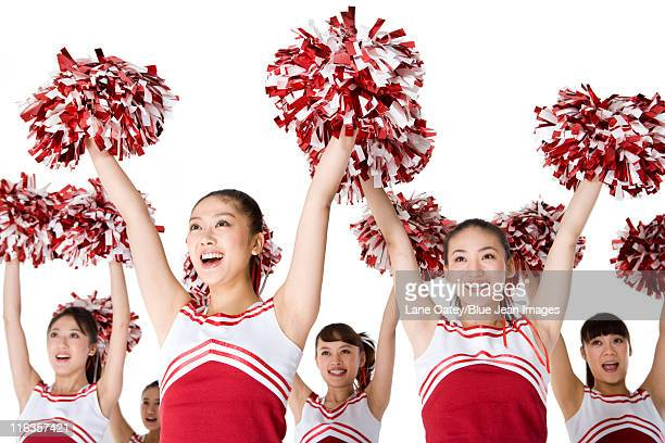 cheerleaders performing a routine - チアリーダー ストックフォトと画像