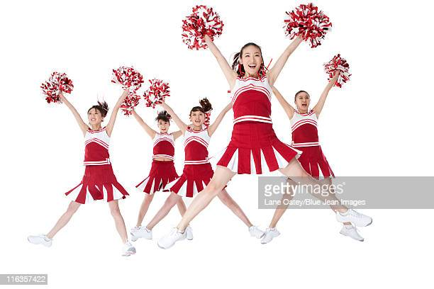 cheerleaders performing a routine - asian cheerleaders stock photos and pictures