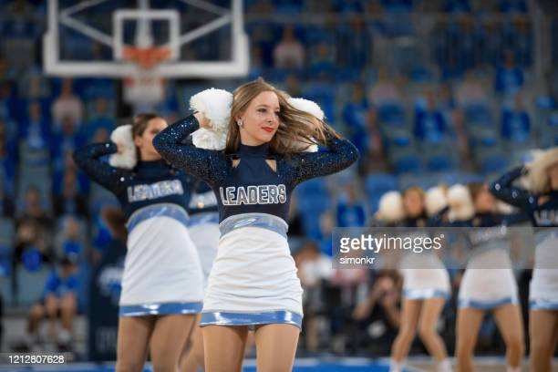 cheerleaders performing in basketball court - nba stock pictures, royalty-free photos & images