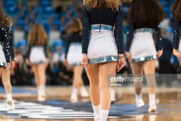 cheerleaders performing in basketball court - sports round stock pictures, royalty-free photos & images
