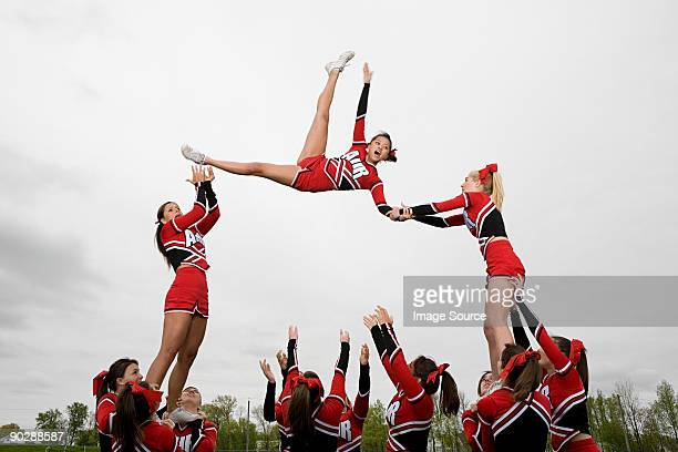 cheerleaders performing routine - asian cheerleaders stock photos and pictures