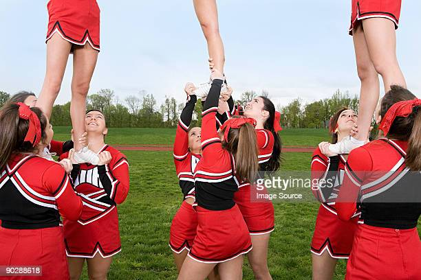 cheerleaders performing routine - bow legs stock photos and pictures