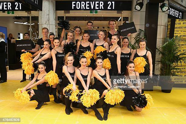 Cheerleaders pose at the opening of the 'FOREVER 21' flagship store on Pitt Street on June 10, 2015 in Sydney, Australia.