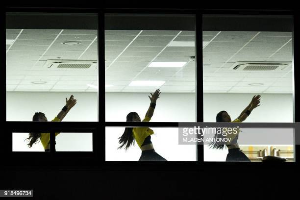 Cheerleaders practise before the men's 10,000m speed skating event in the Gangneung Oval during the Pyeongchang 2018 Winter Olympic Games in...