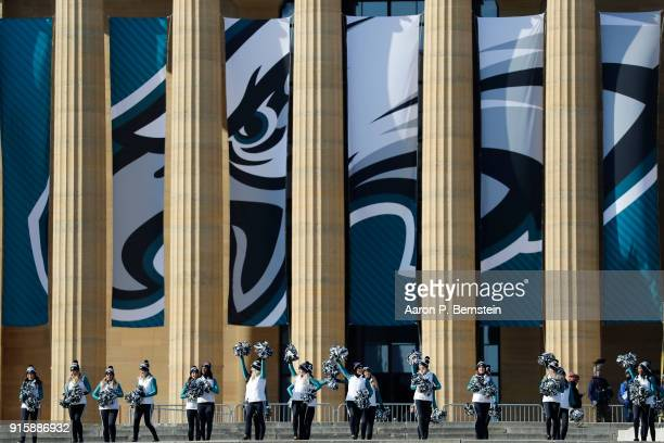Cheerleaders rev up the crowd as they wait for the Philadelphia Eagles Super Bowl parade to arrive on February 8 2018 in Philadelphia Pennsylvania