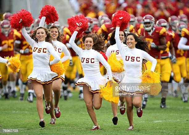 Cheerleaders run onto the field ahead of the USC Trojans before the game with the Washington State Cougars on September 22 2007 at the Los Angeles...