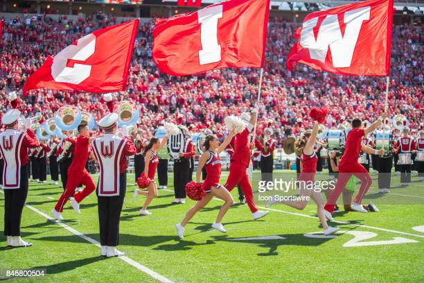 UW cheerleaders run onto the field prior to an NCAA football game between the Florida Atlantic Owls and the Wisconsin Badgers on September 9 2017 at...