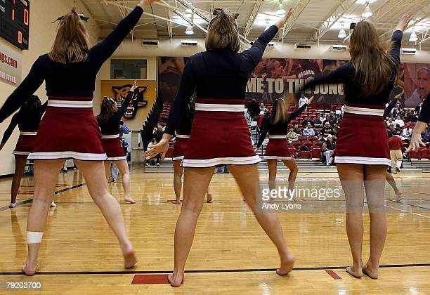 Cheerleaders show support for Ron Hunter the Head Coach of IUPUI by also being without shoes during the game against Oakland at The Jungle on January...