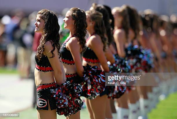Cheerleaders stand during the National Anthem prior to the game between the Georgia Bulldogs and the South Carolina Gamecocks at Sanford Stadium on...