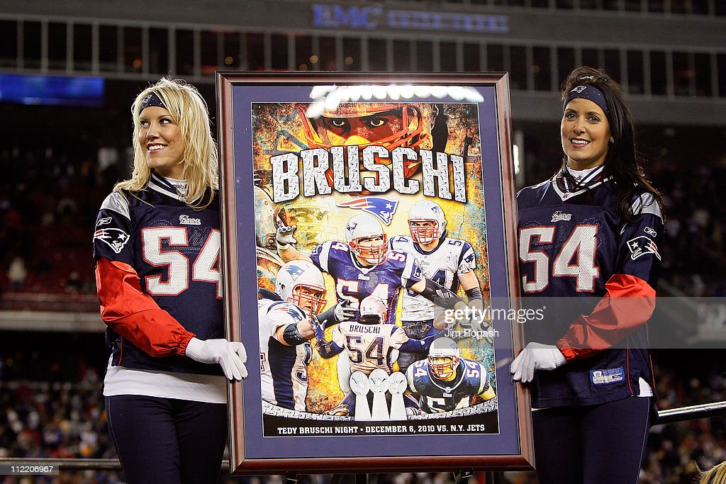 Cheerleaders stand mext to a frame photo montage honoring former New England Patriots linebacker Tedy Bruschi during a halftime ceremony honoring his playing career as the Patriots host the New York Jets at Gillette Stadium on December 6, 2010 in Foxboro, Massachusetts.