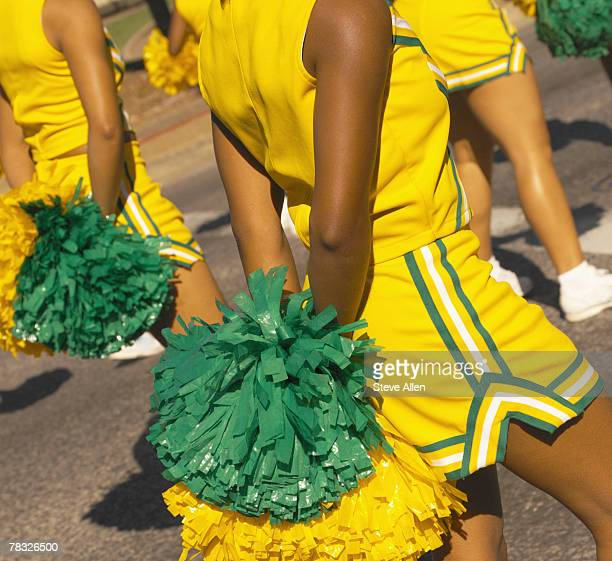 cheerleaders with pompoms - black cheerleaders stock photos and pictures