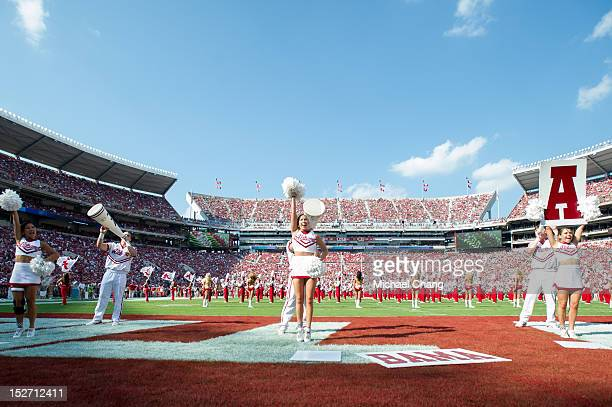 Cheerleaders with The Alabama Crimson Tide waves to the crowd while playing against the Florida Atlantic Owls on September 22 2012 at BryantDenny...