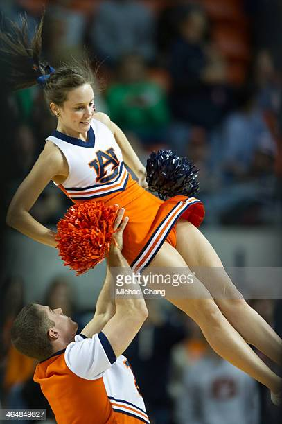 Cheerleaders with the Auburn Tigers perform during their game against the Florida Gators at Auburn Arena on January 18 2014 in Auburn Alabama Florida...