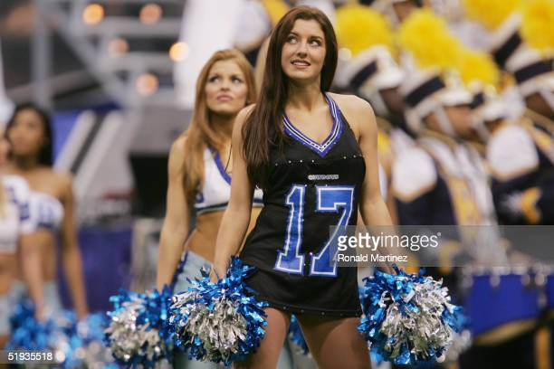 Cheerleaders with the Dallas Cowboys perform while the Cowboys play the Chicago Bears on November 25 2004 at Texas Stadium in Irving Texas