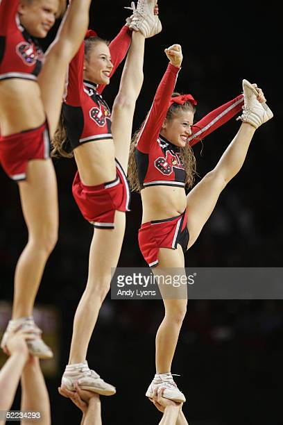 Cheerleaders with the Louisville Cardinals perform as they play against the Lafayette Leopards during the game at Freedom Hall on December 4, 2004 in...
