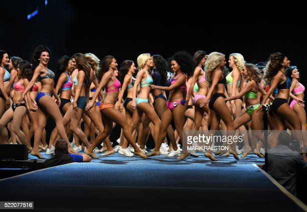 TOPSHOT Cheerleading candidates parade on stage during the Los Angeles Rams Cheerleading Final auditions at the Forum in Los Angeles California on...