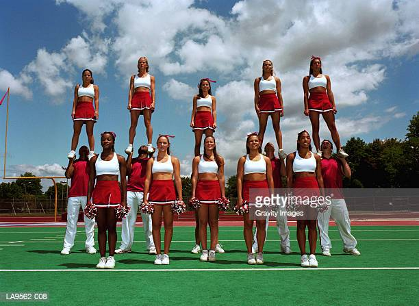 cheerleading squad, portrait - cheerleaders stock pictures, royalty-free photos & images