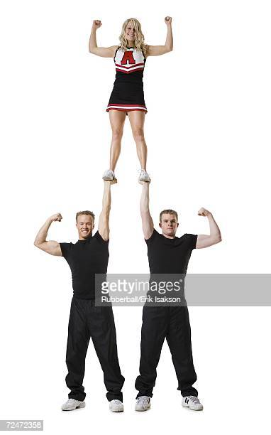 cheerleading team - cheerleaders stock pictures, royalty-free photos & images