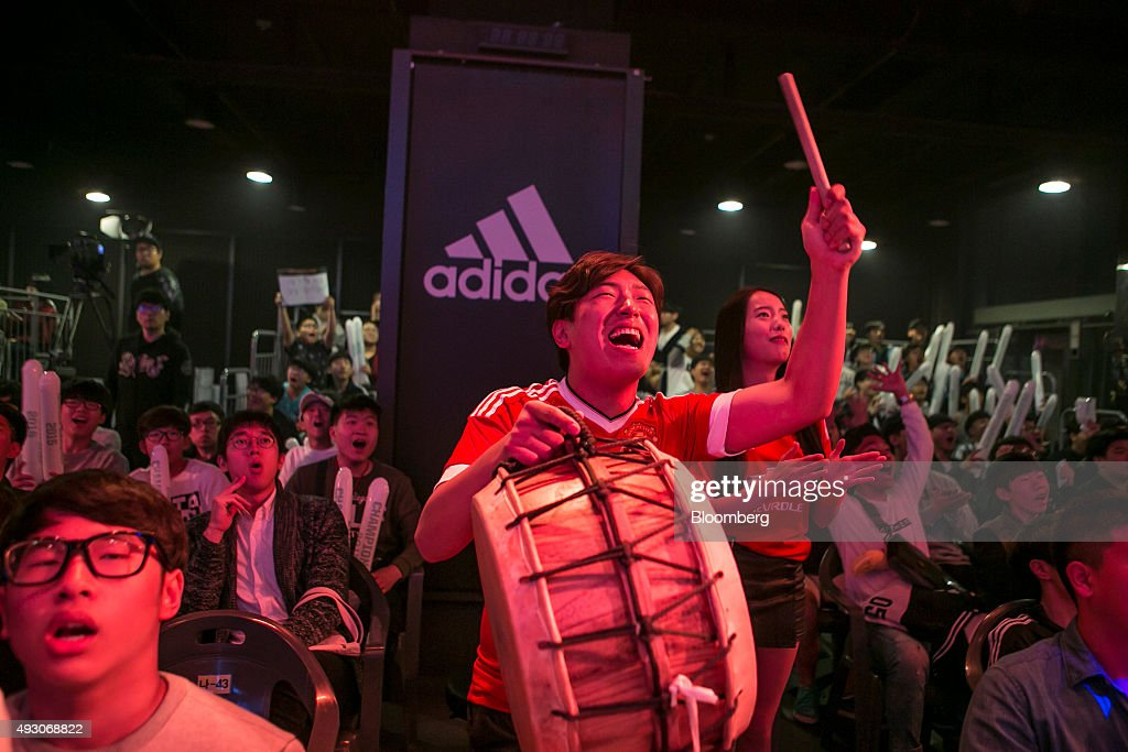 A cheermaster leads the crowd as they watch the final round of the Electronic Arts Inc. (EA) Sports FIFA Online Championship at the Nexon Co. e-Sports Stadium in Seoul, South Korea, on Saturday, Oct. 17, 2015. Video game competitions, known as eSports, have been expanding as gamers seek to shift perceptions around their craft from a basement hobby to a serious money making industry. Photographer: Jean Chung/Bloomberg via Getty Images